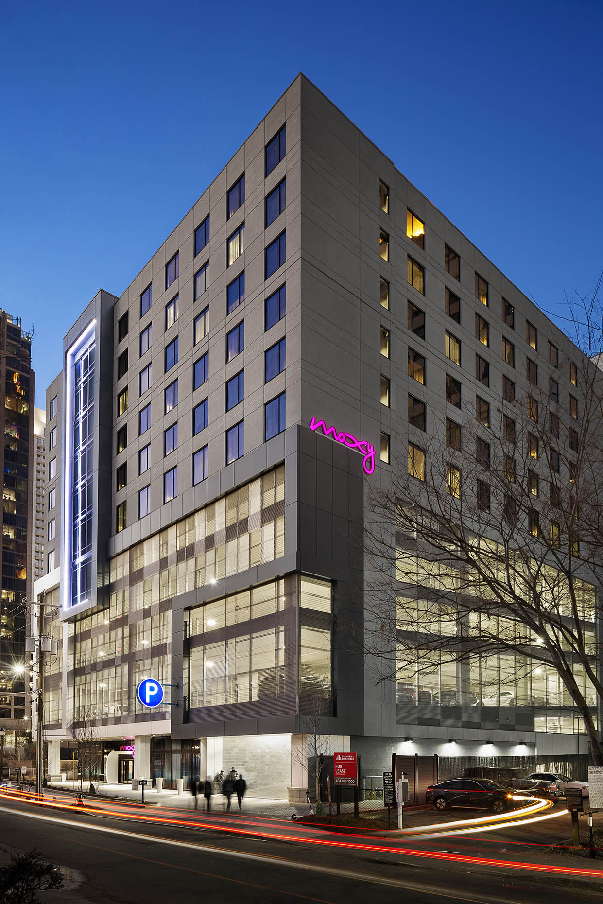Winter_ACMoxyHotel_ATLMidtown_1.14.19_Exterior_Moxy_Front_Twilight.2_people_webuse.jpg