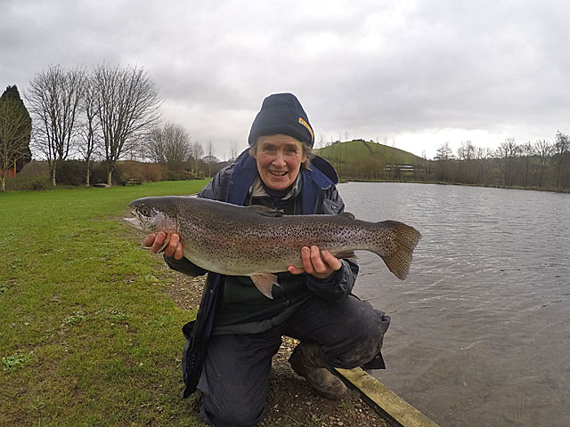 A very happy Rosie Coles with her 8lb 1oz Rainbow caught using a Flexi Black Zonker