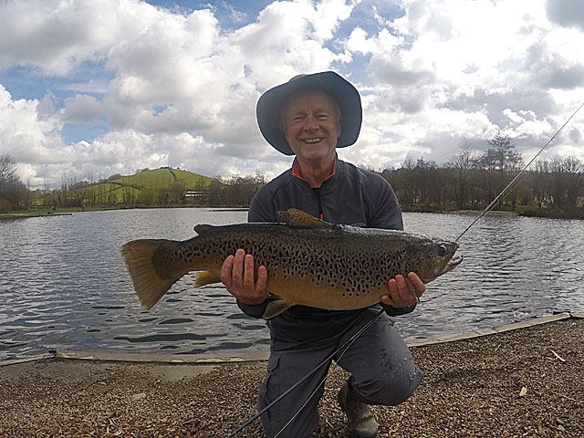 Elated angler Dr Mike Webster with his 14lb 10oz fishery record Brown Trout.  Nice work!