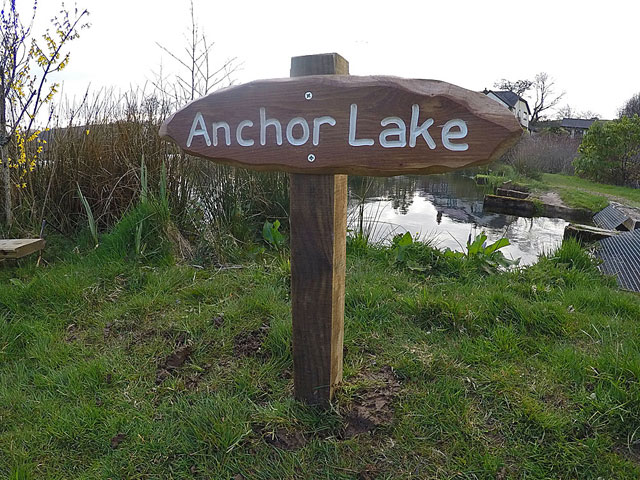 Anchor lake fitted out with its new wooden sign