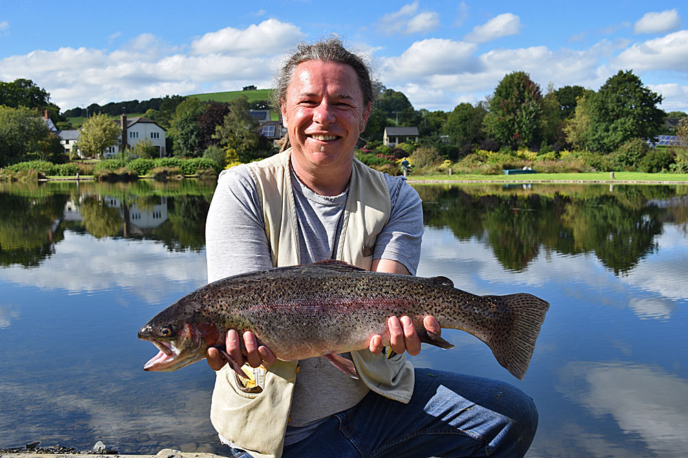Shaun Rowden with the 6lb 4oz Rainbow he stalked during a beautiful day on Anchor Lake