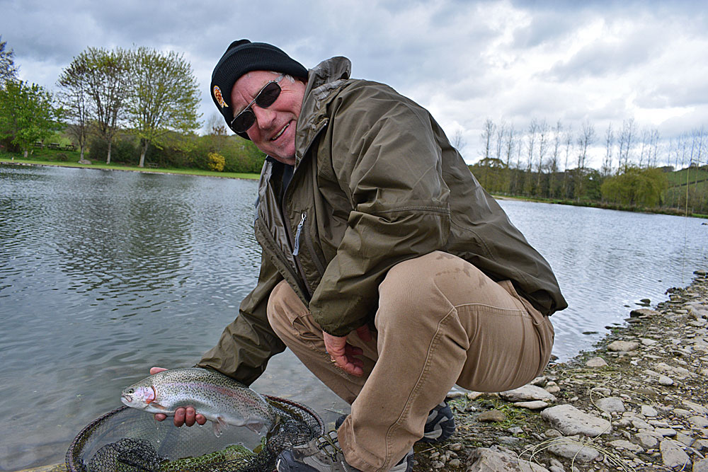 Visiting from America, first time fly angler Derek Beckman with his first ever Trout and he caught it using a dry fly!