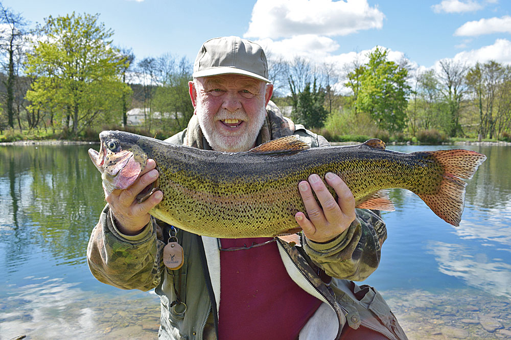 Mr Gilbert from Barnstaple with his 9lb 1oz Rainbow which he caught using a Dry Fly!