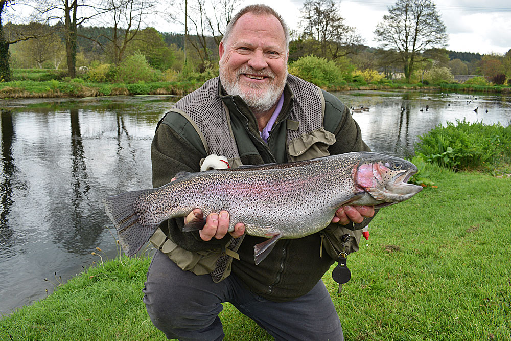 Simon Curtis with another fulled tailed Rainbow which he caught on Anchor Lake, part of a 4 fish bag for 20lb.  Simon also released a further 2 fish.