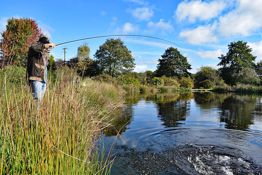 Wayne bends into a hard fighting Exe Valley Trout - image by Nick Hart