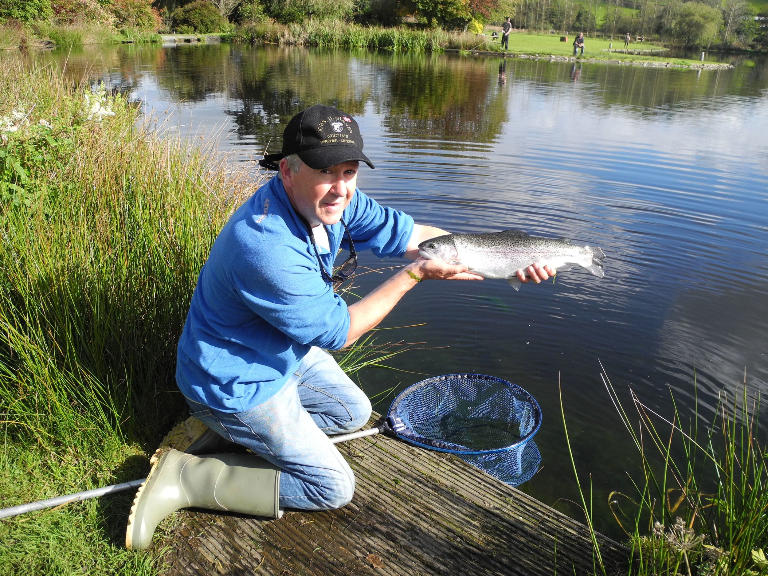 Wayne with a bright Exe Valley Rainbow - caught using a dry fly in October!