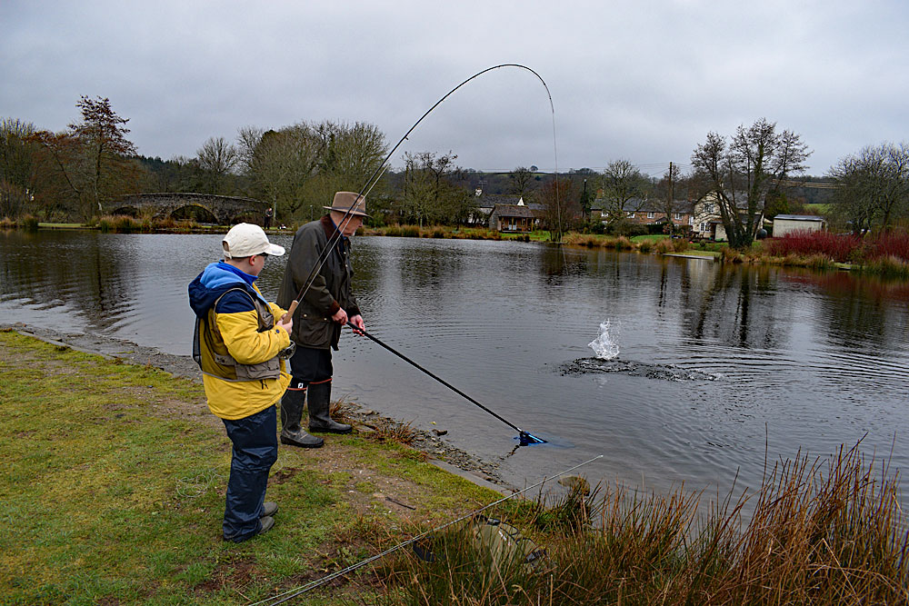 Ten year old Sam Shepherd shows us all how its done, playing a fish to granddad Stuarts net!