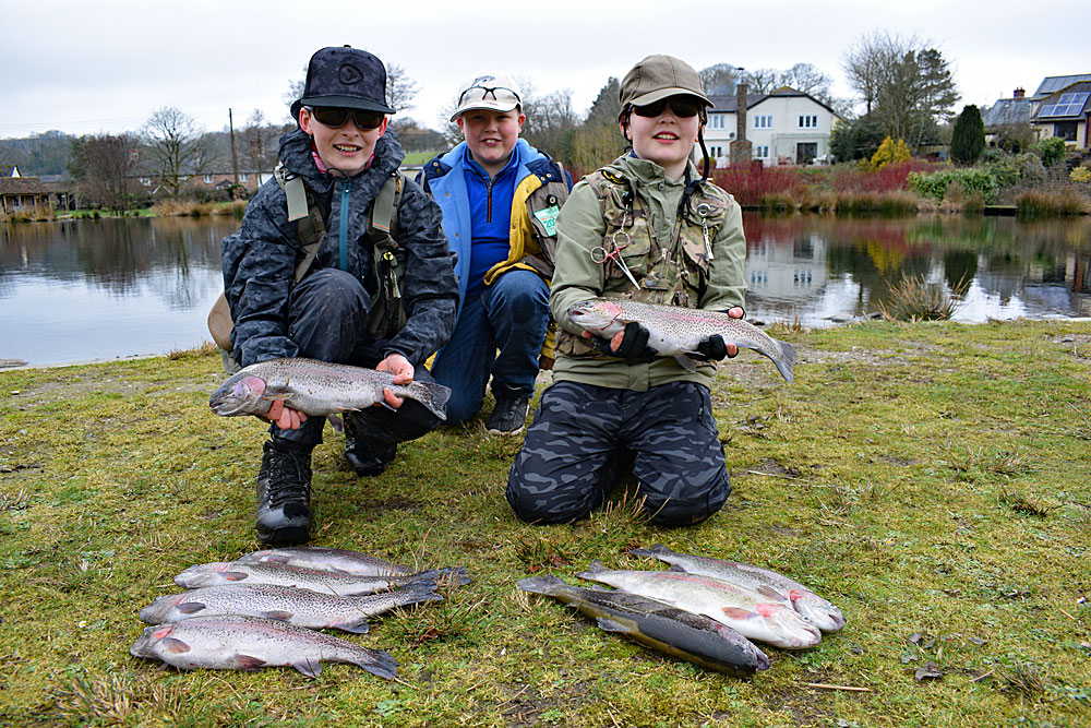 The Mockridge Brothers (fish off winner James is on the left) show off their catches.