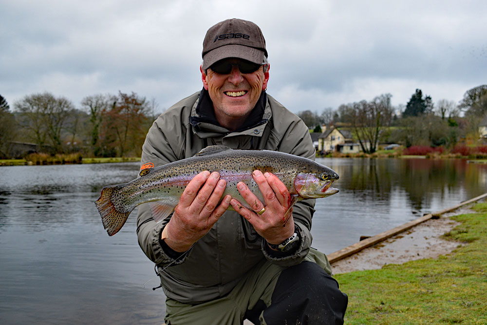 John Slaven looking very pleased with a quality rainbow caught while fishing deep during the 2018 Exe Valley Troutmasters fish off.