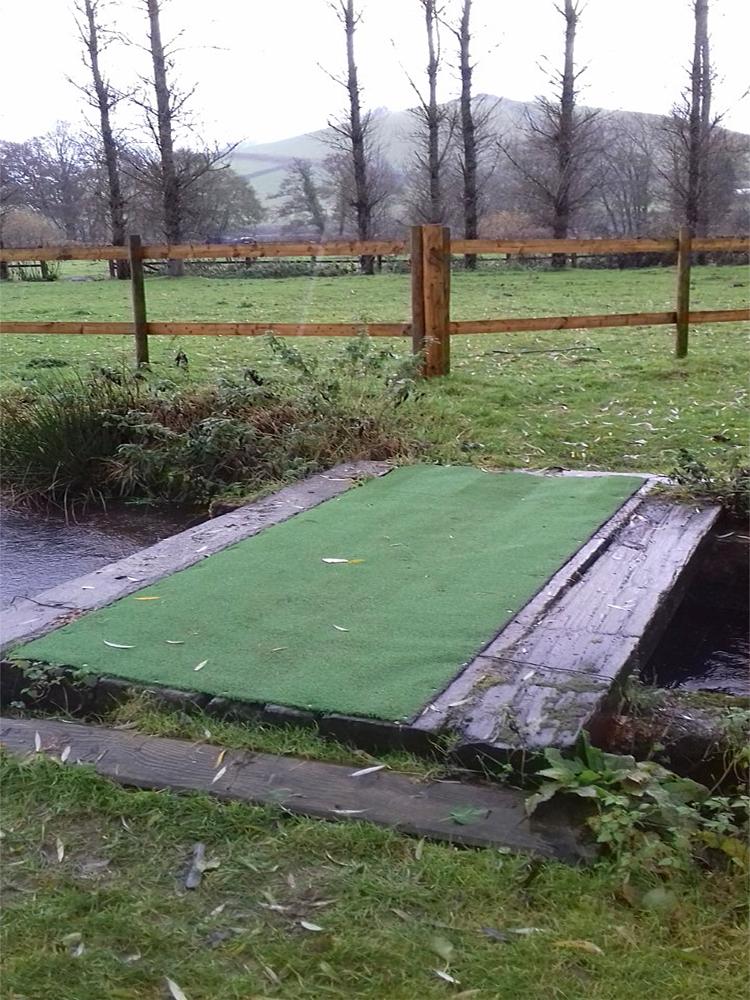 Non-Slip artificial grass installed on the feeder stream bridge