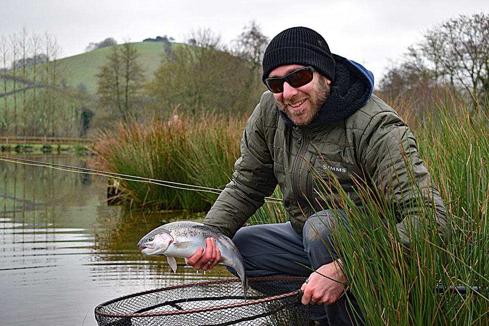 "Ben Cheeld from Taunton with a beautiful silver fish caught using a floating line and static nymph, he added 3 more to his total (all released) and fished another session on 30/12/18, banking another 9 fish, this time using a New Zealand dropper set up leaving the comment  ""Cracking Day!"""