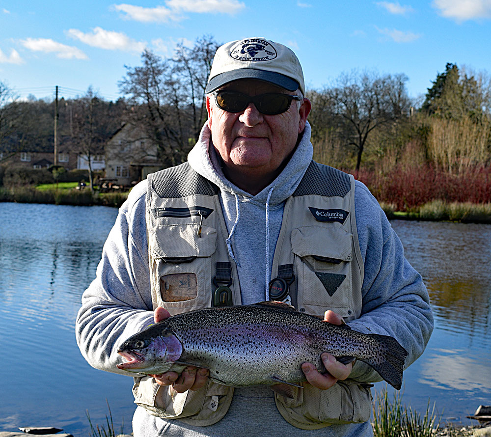 John Gilmore with one of his 9 hard fighting Rainbow Trout from Anchor Lake