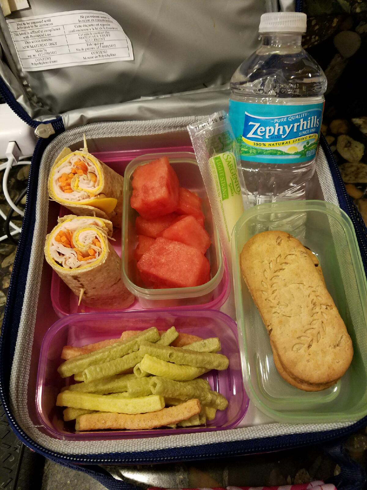 """Whole wheat turkey wraps and string cheese with watermelon and veggie chips :-) And cannot forget the """"dessert"""" BelVita cookie sandwich made with dark chocolate spread!"""
