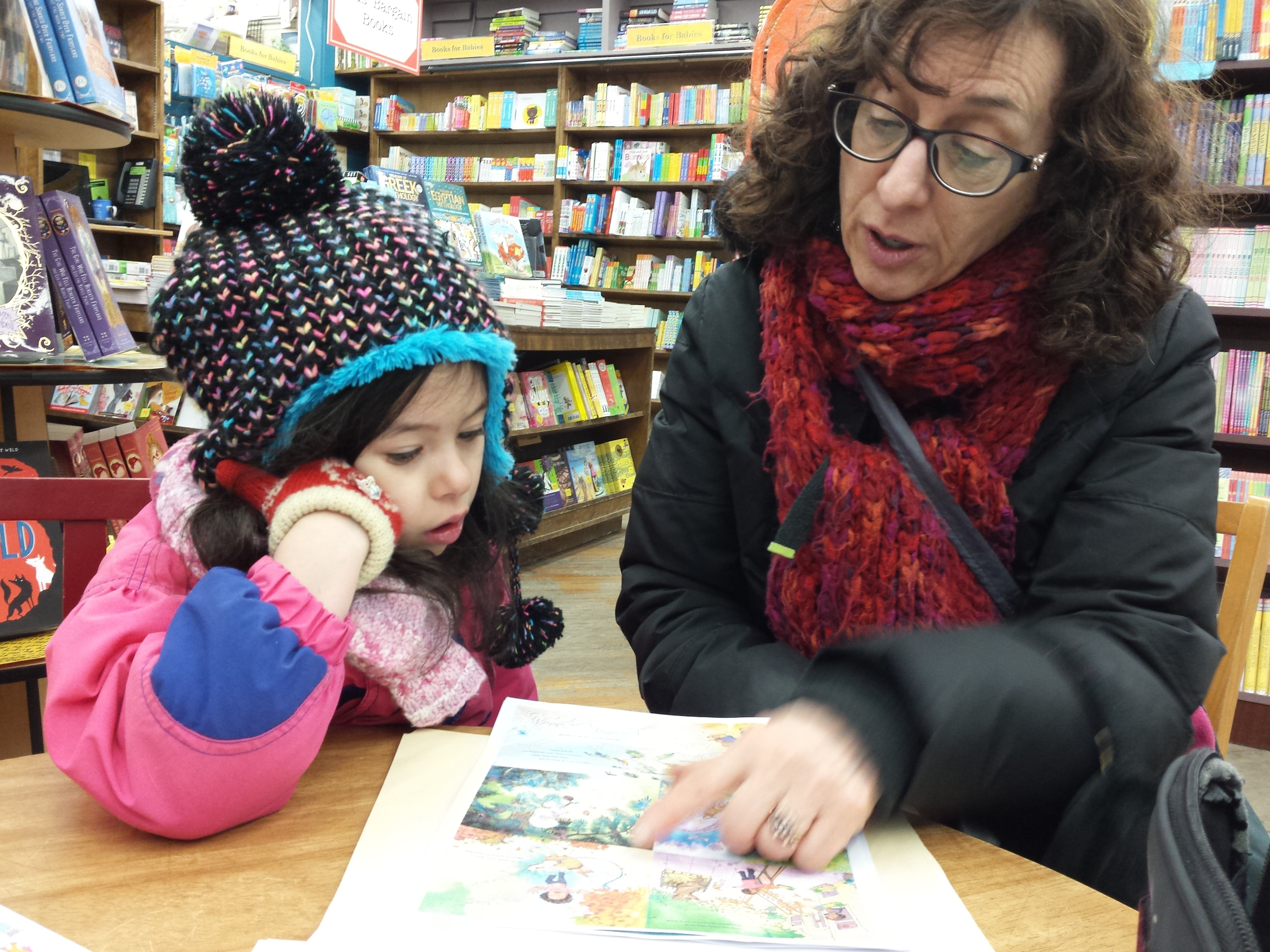 Mollie looks at the galleys with her author aunt. Brookline Booksmith, March 2015