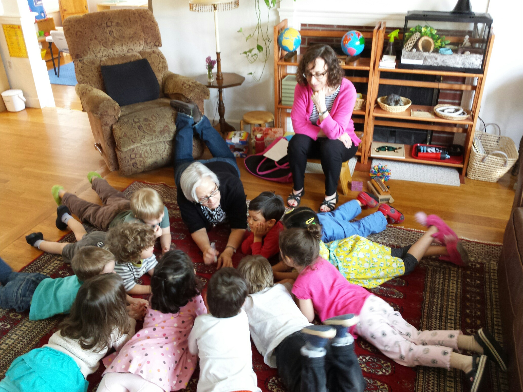 """Karen and the kids demonstrate the """"Silence Game"""" with an egg timer."""