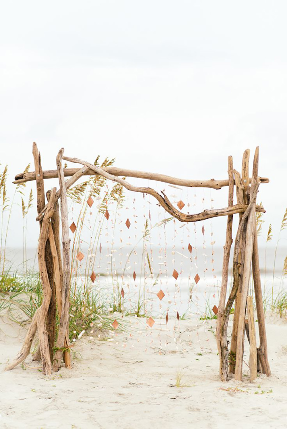 Whimsical driftwood arch on the beach.