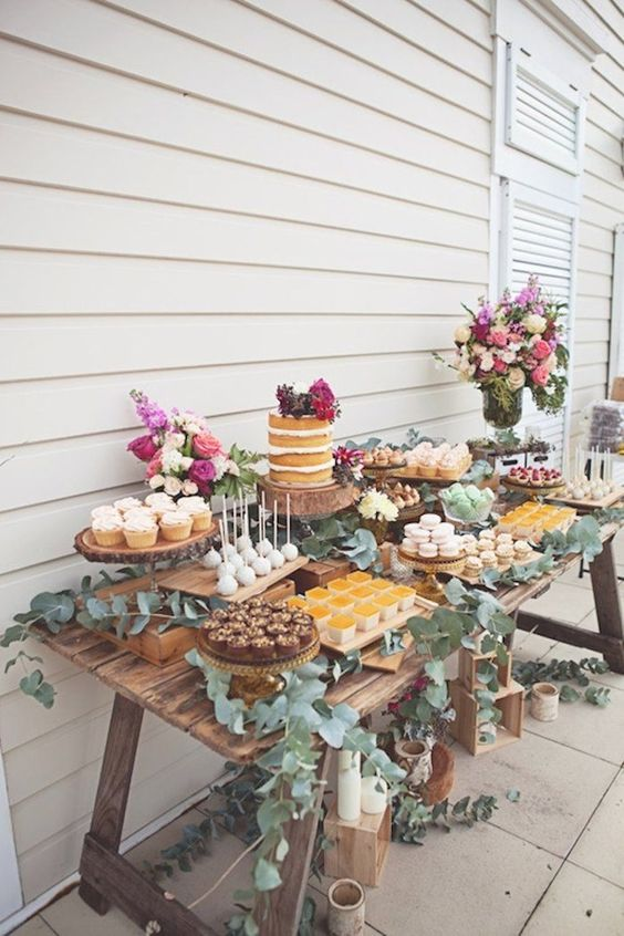 A farmhouse style table made of reclaimed wood is a lovely setting for the ever important dessert table!