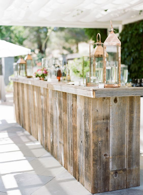 Don't forget the bar! Reclaimed lumber can be incorporated into almost any aspect of your wedding's decor, even the bar as seen here.