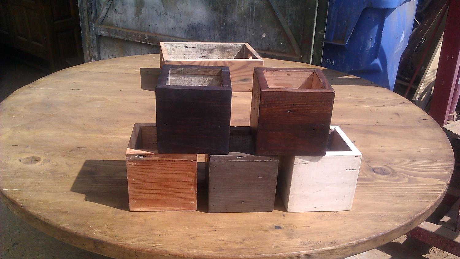 A selection of CC Design's wooden cubes for centerpieces shown in a variety of color finishes.