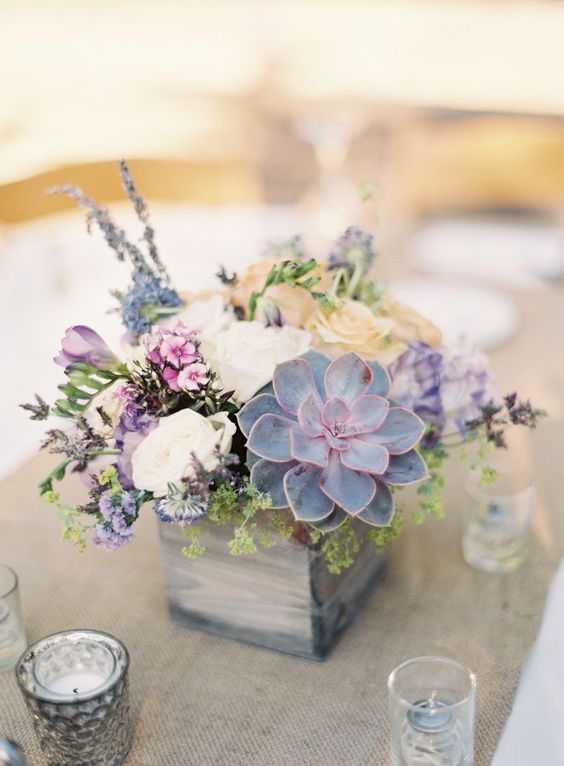 Cute succulent centerpiece given a rustic vibe thanks to its wooden box container.
