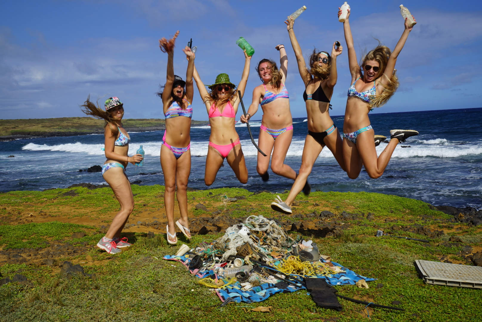 """Alison Teal (third from left), some YouTubers, and a pile of plastic pollution hauled off the reef in Hawaii Oct. 14. """"We combed the beach for hours collecting micro and macro plastics with labels from all over the world. Happy to have their help cleaning up the planet and posting videos on their YouTube channels, and excited to see what further research Kontiki2 will bring the world on the ocean, micro plastics and is effect on ocean life.South Point is a 'catch all' for trash from all over he world. The beach has layers of micro plastic. The YouTubers are eager to make a difference in the world."""""""