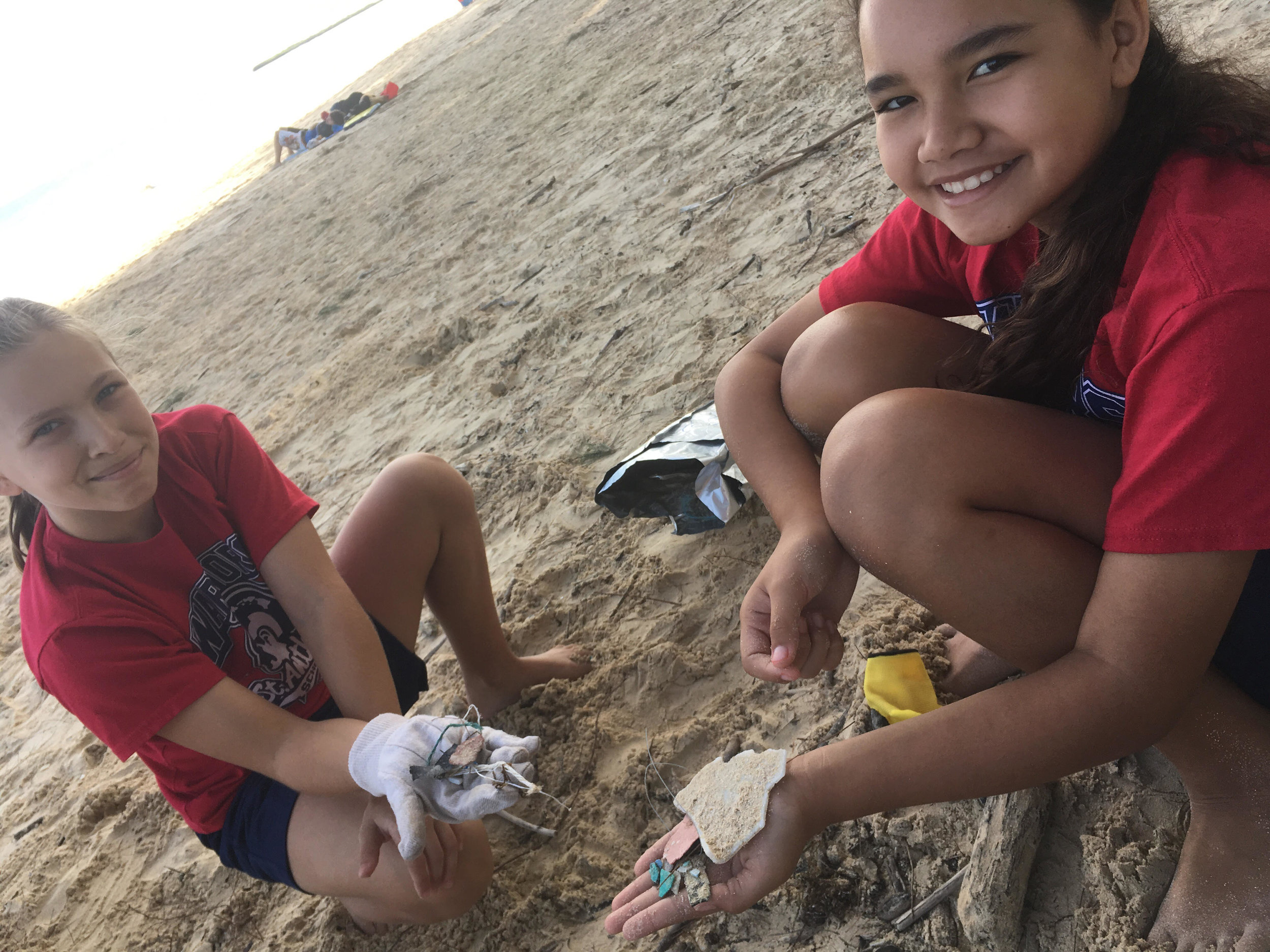 Scenes from a beach cleanup. Photos by  Kōkua Hawaiʻi Foundation