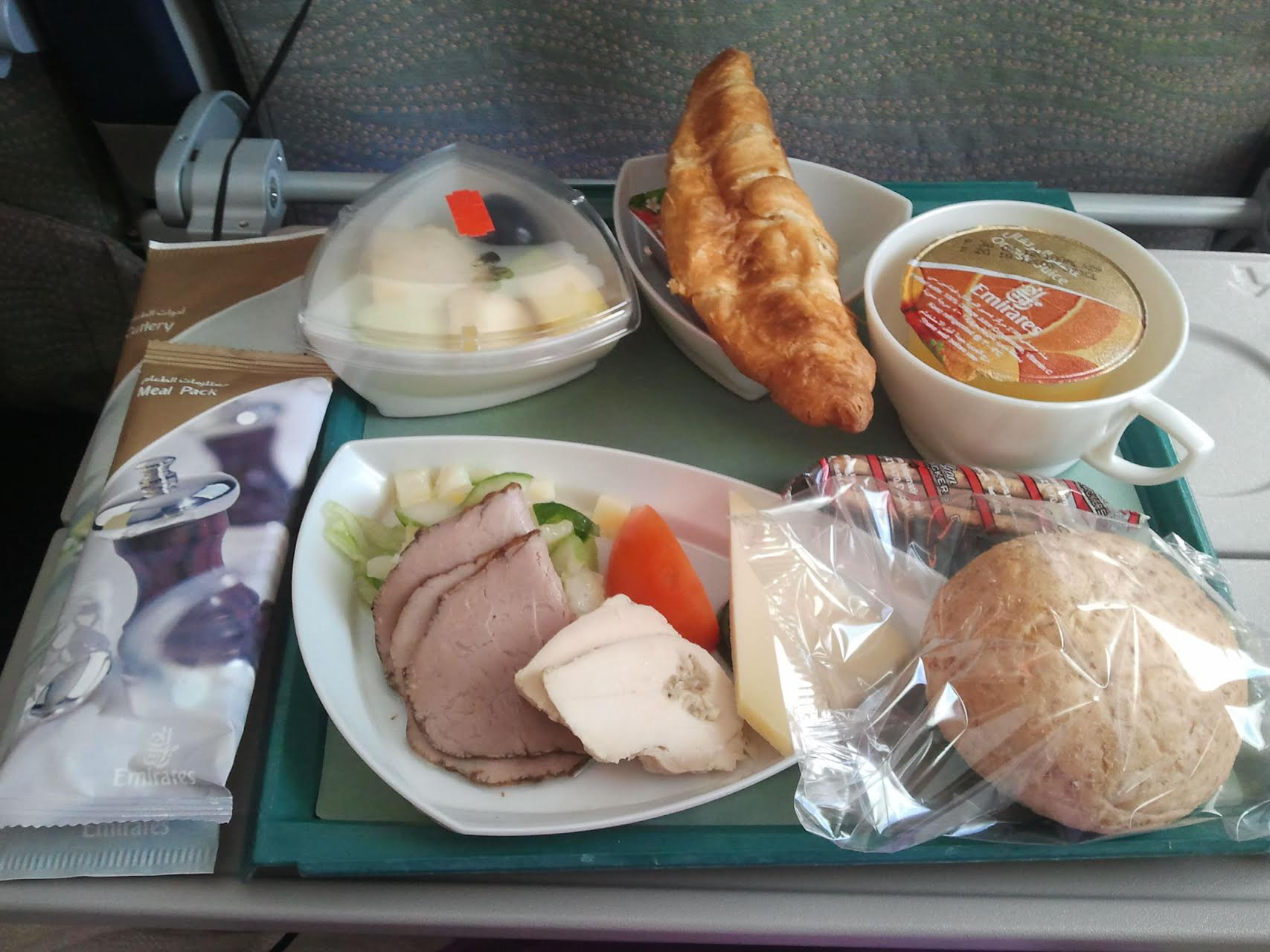 Plastic-wrapped food on an Emirates flight. Photo by Nicolas Delaunay.