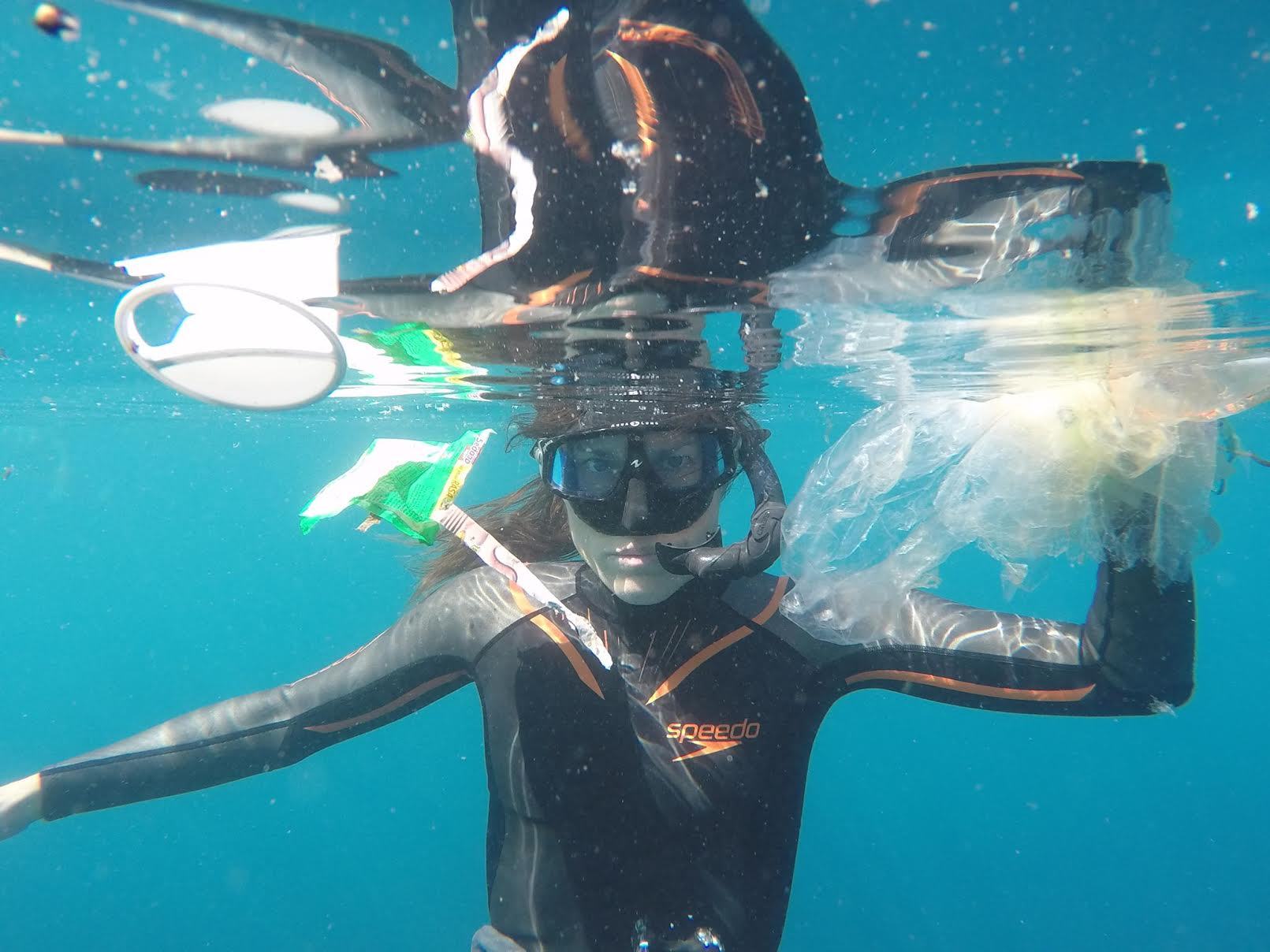 Anita Horan finding plastic on a dive. Photo by Tim Horan.