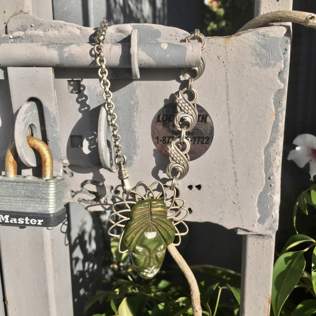 JG Jadeite Necklace on Fence.jpg