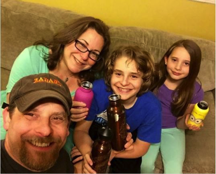 The Mogel family shows off their reusable bottles