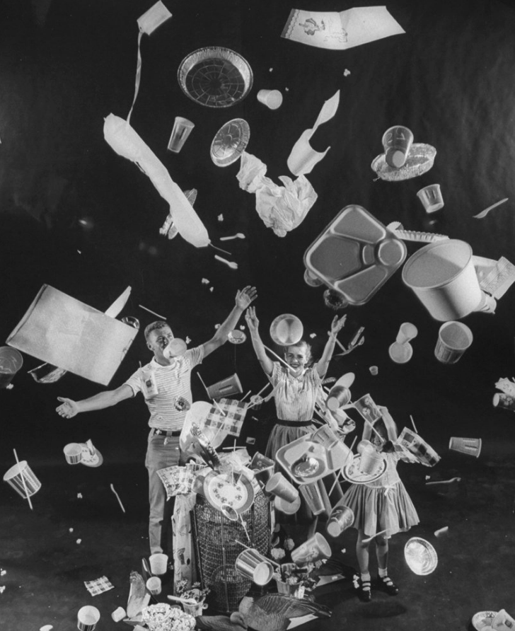 "A man, woman and child toss ""disposable"" items into the air, 1955. Peter Stackpole—The LIFE Picture Collection/Getty Images"