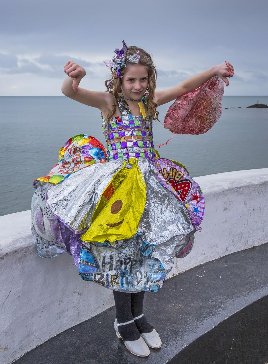 Ellie Jackson's daughter wears a dress made of discarded balloons created by Linda Thomas.