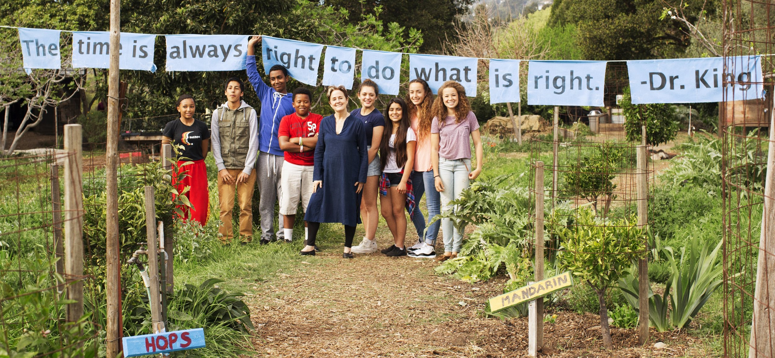 Alice Waters with students in her Edible Schoolyard Project, which advocates for a free school lunch for all children and a sustainable food curriculum in every public school.