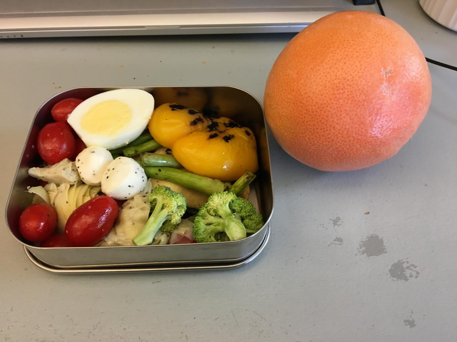 Lynn uses stainless steel containers for meals while traveling.