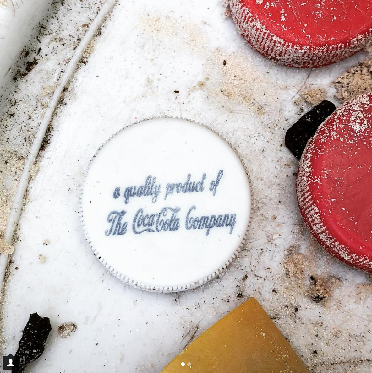 Coca-cola bottle cap found during the beach clean up and brand audit. Photo by Dianna Cohen.