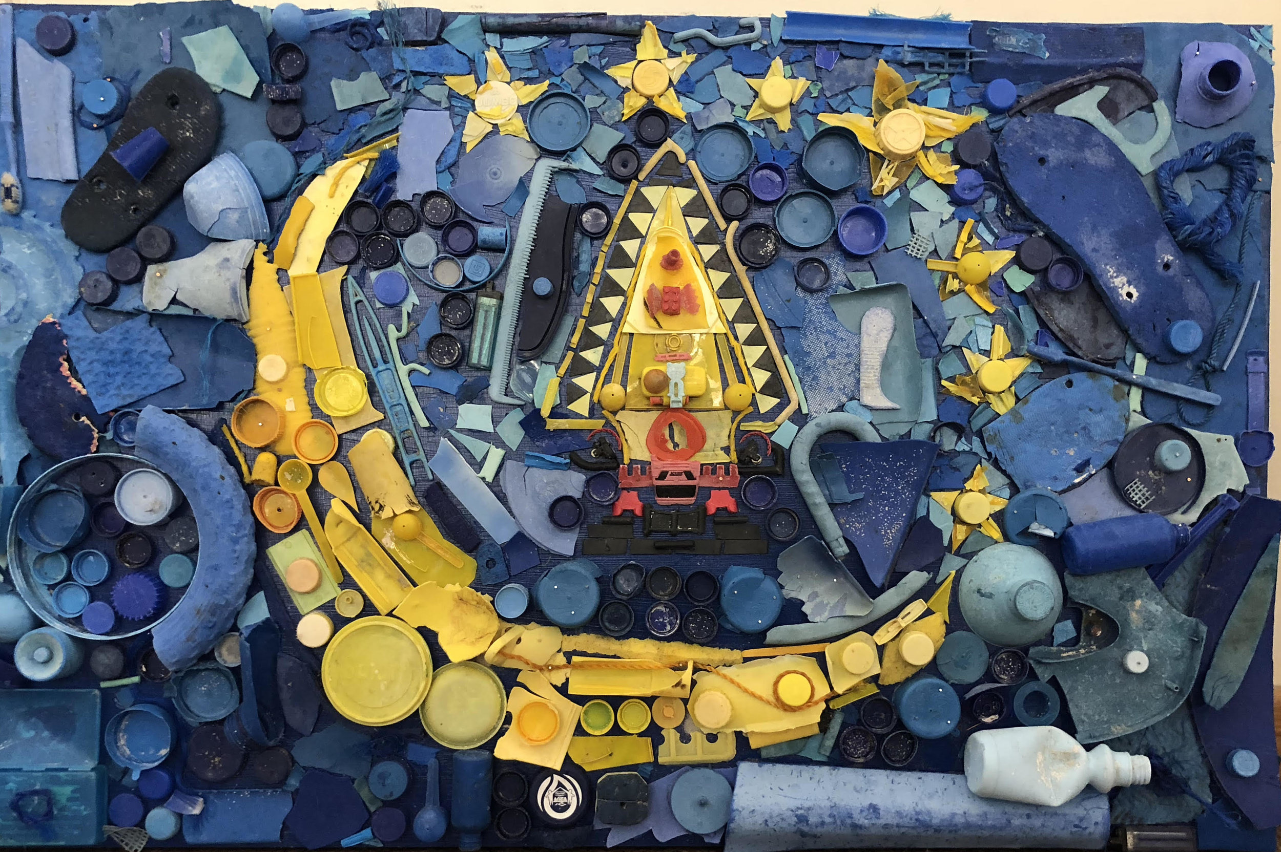 Art made from beach plastic, recreating the State of Koror flag. Photo by Dianna Cohen.