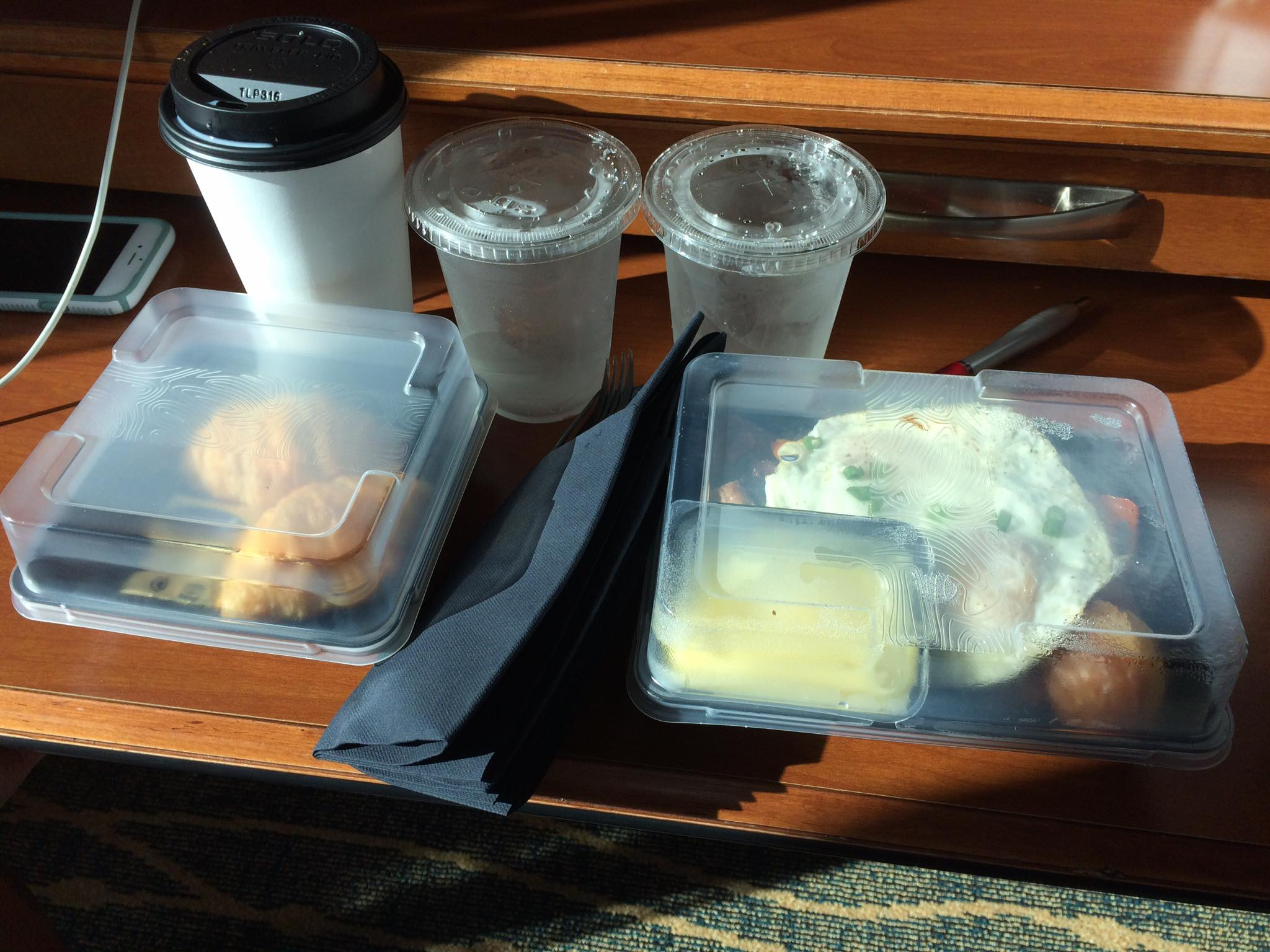 Photo of plastic containers from a Seattle-area Marriott by Raj Mahakul.