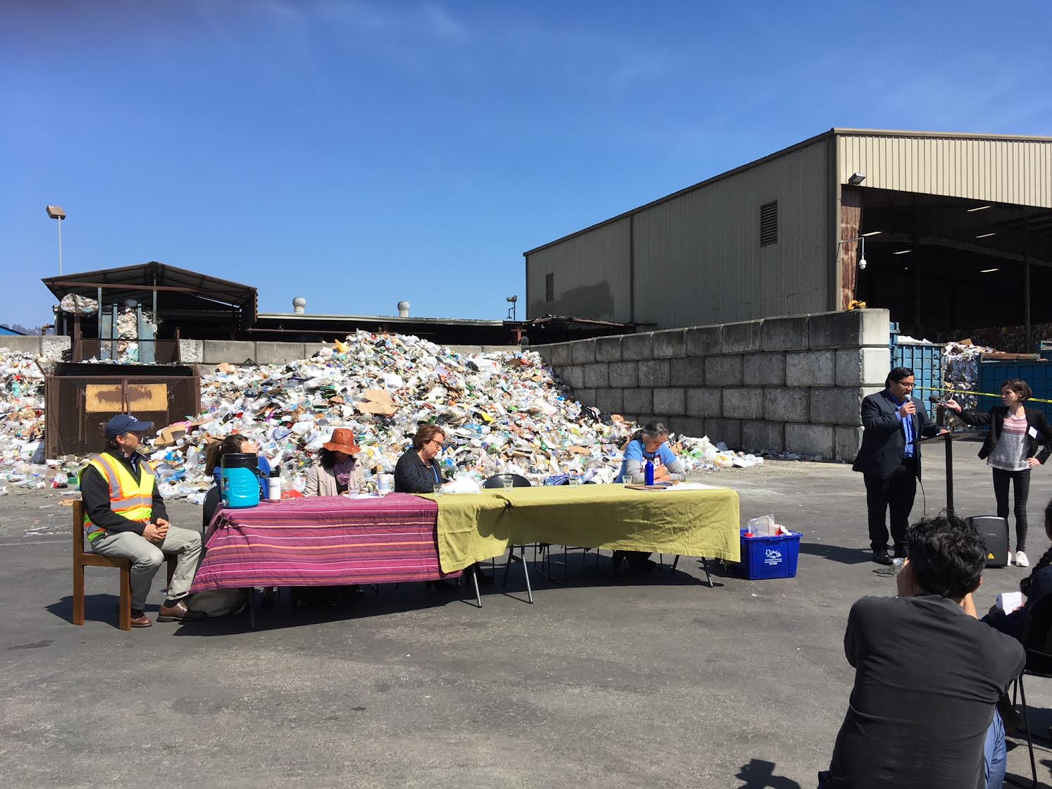 At a press conference held by Ecology Center, a day's worth of single-use plastic trash is visible.