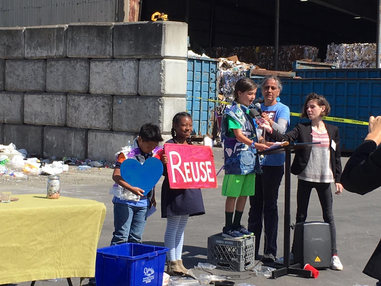 Teacher Jacqueline Omania with 3rd graders speaking at a press conferences in favor of the ordinance on April 24.