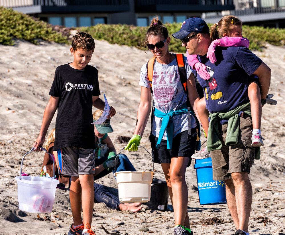 Volunteers in Santa Cruz, CA, use buckets to collect waste. Image via  Save Our Shores.