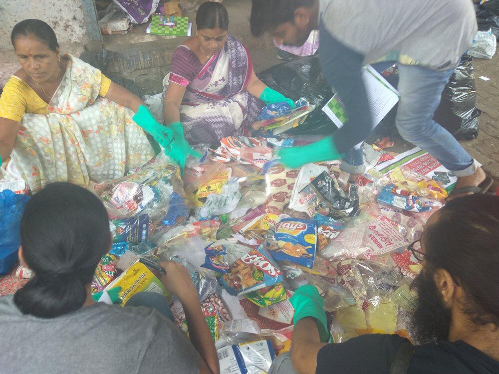 Volunteers sort plastic waste at a brand audit in Mumbai, India, image via Break Free From Plastic.