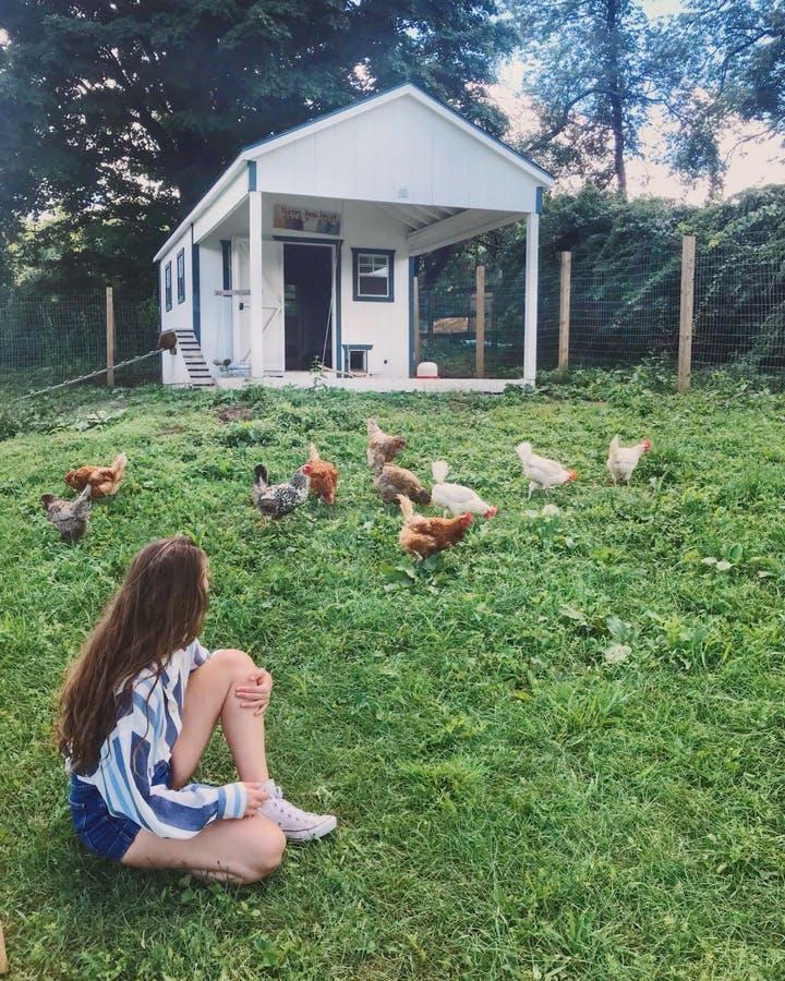 Rima Fara with her cute rescued chicken