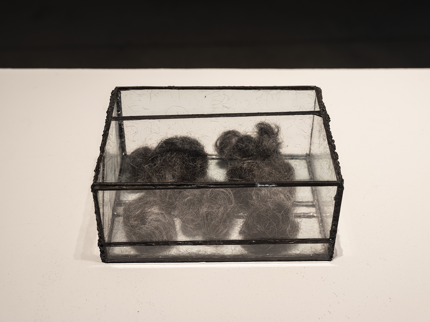 "Reliquary , 2017 Human hair, glass 9"" x 5"" x 3"" Photo: Mark Kasumovic"