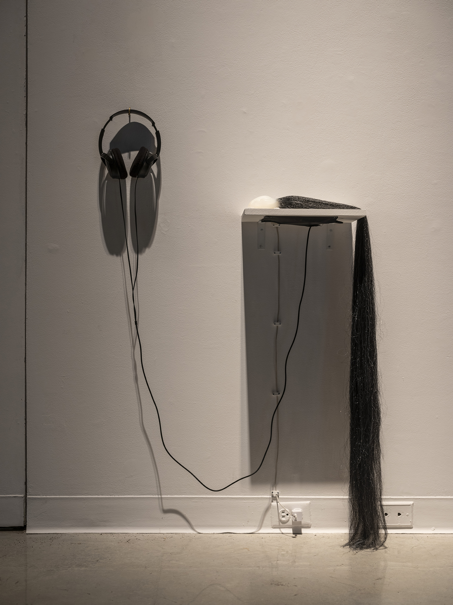 Plug,  2018 Silicone, synthetic hair, audio   and where is the body?,  2018 ArtLab, Western University. London, ON Photo: Mark Kasumovic