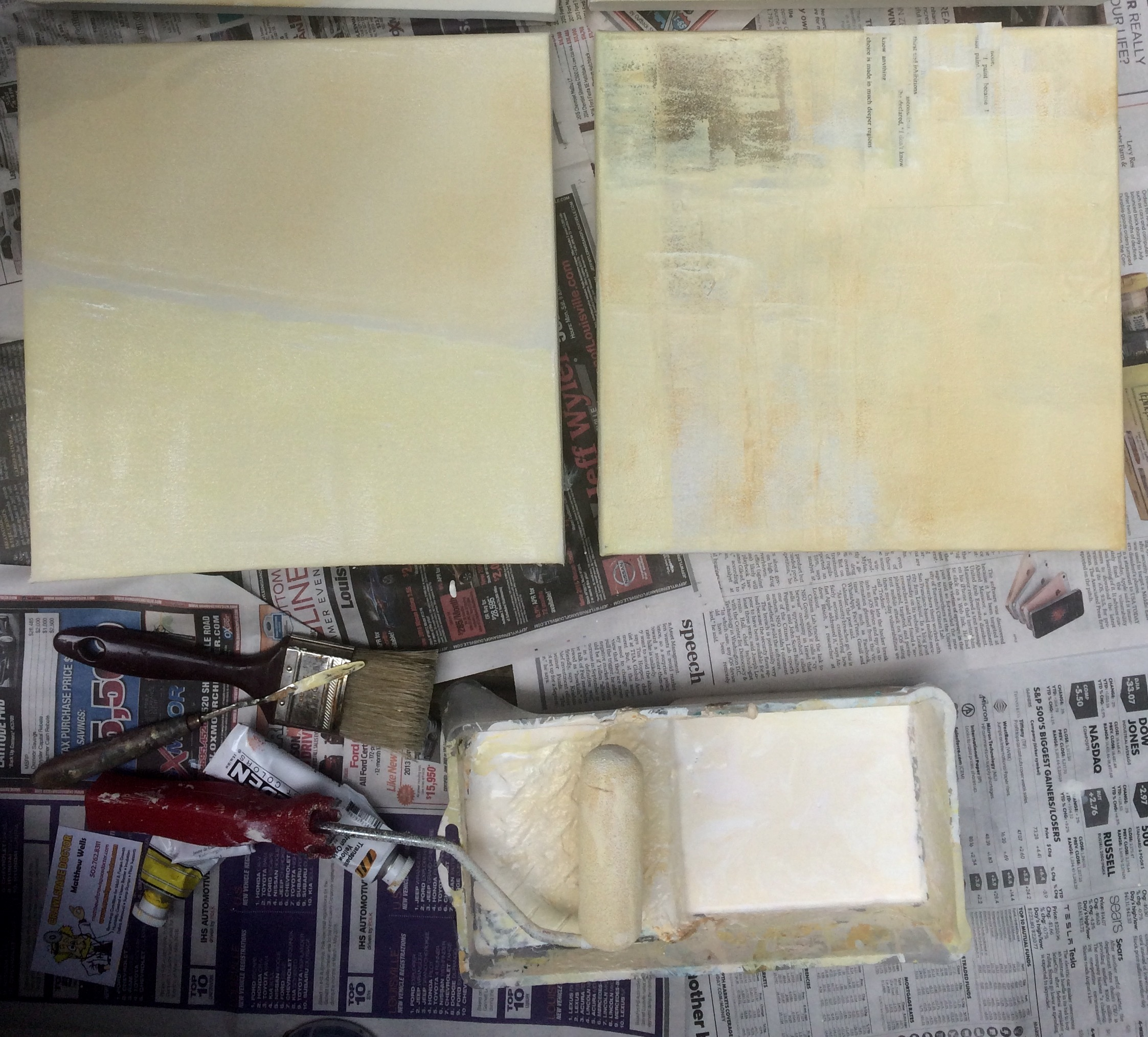 Applying house paint, tinted with Golden acrylic, for the second layer.