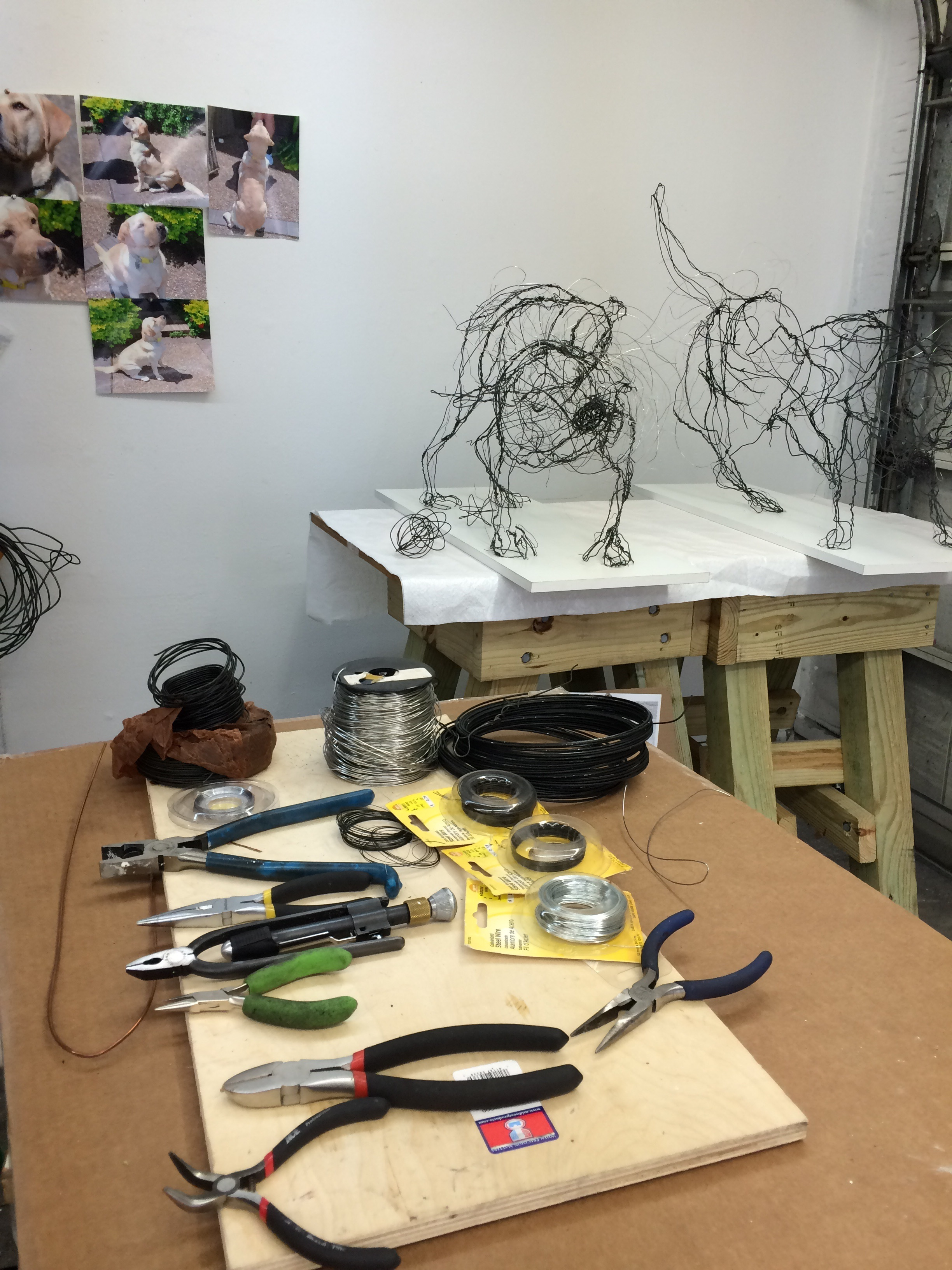 shake shake shake -wire sculptures I and II in the background in the foreground are my pliars, wire cutters and assortments of wire.