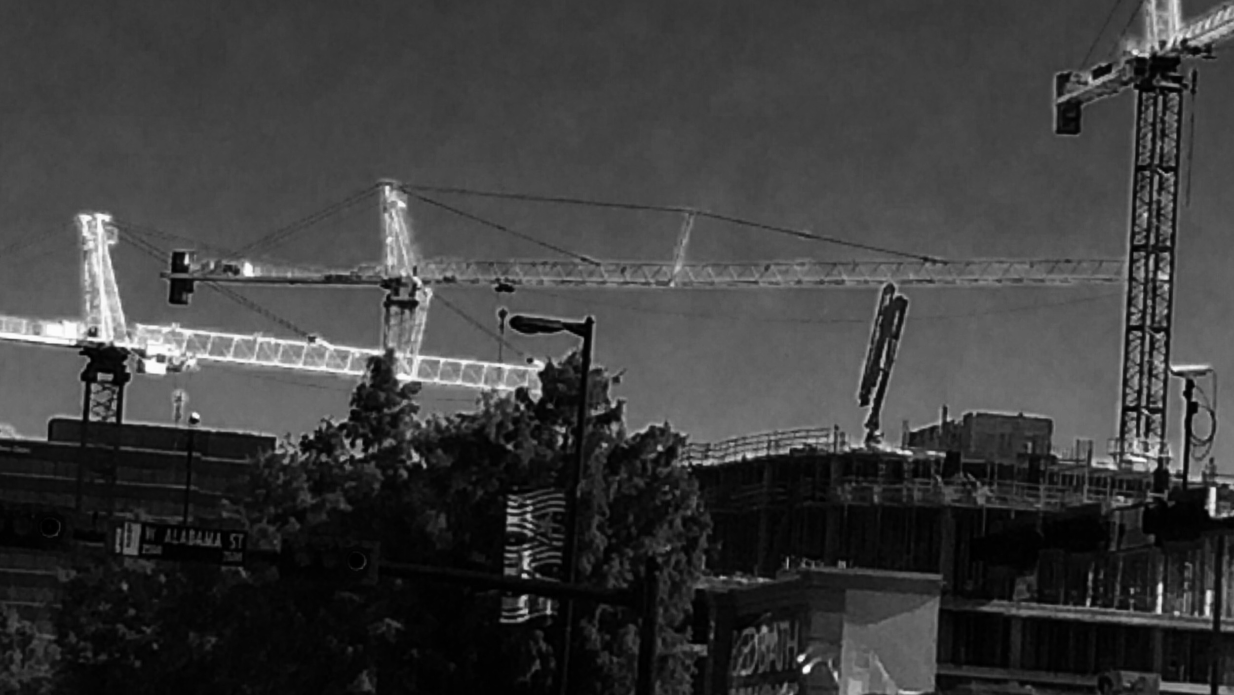 White construction cranes on Kirby drive.