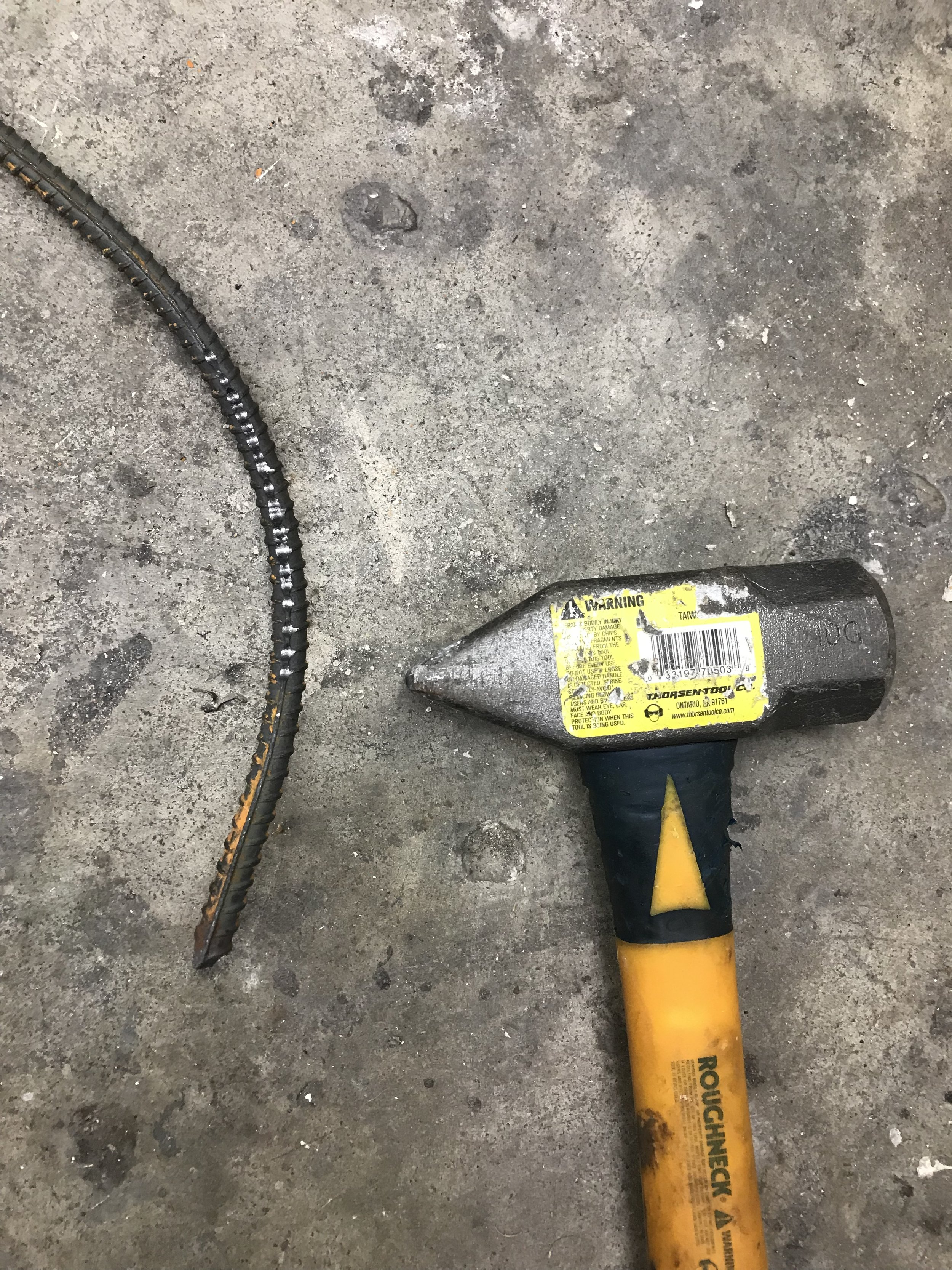 With small taps I use a sledgehammer to make a gentle curve to a leg.