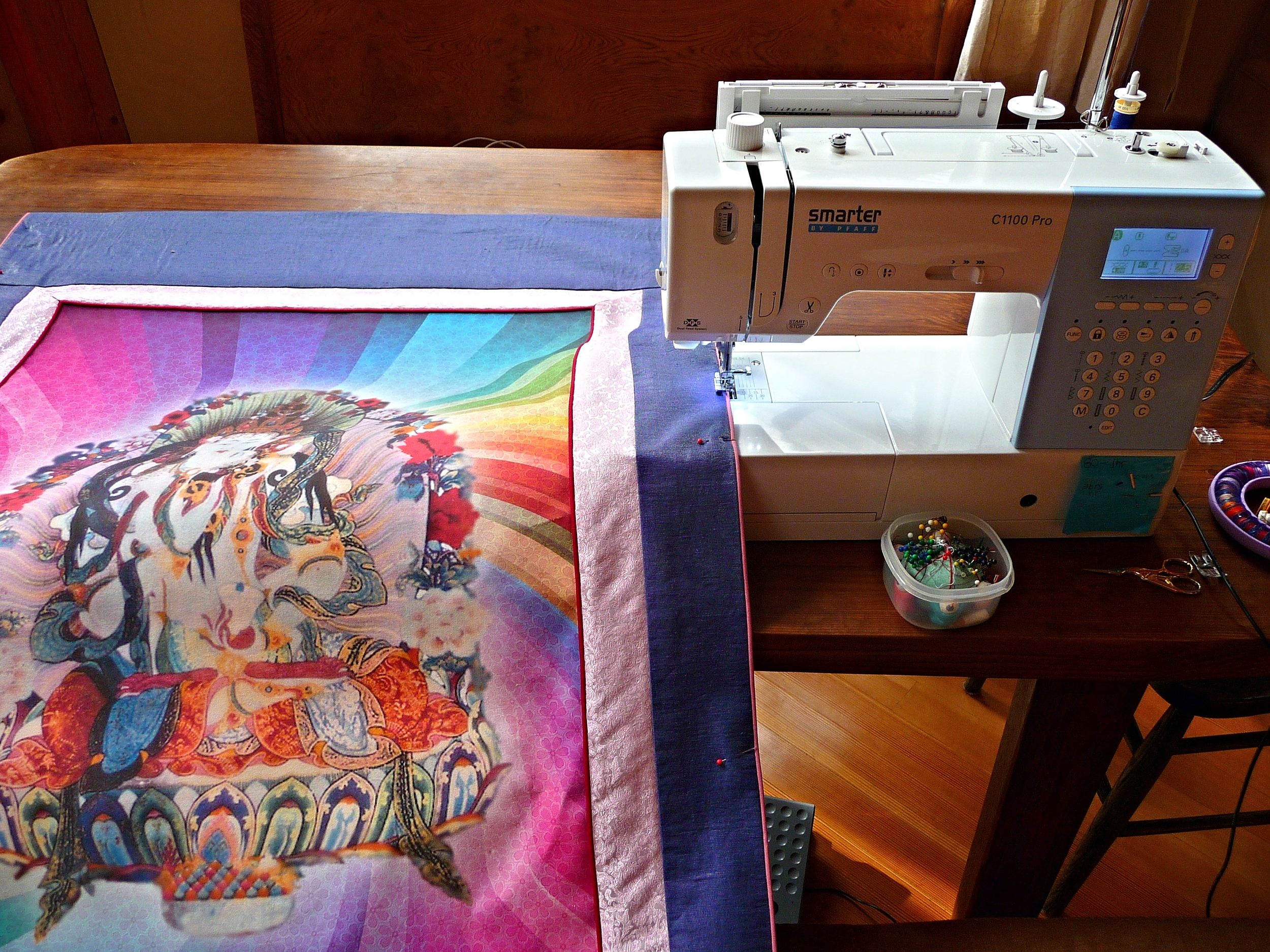 Sewing on the piping on the sides of a Thangka Frame