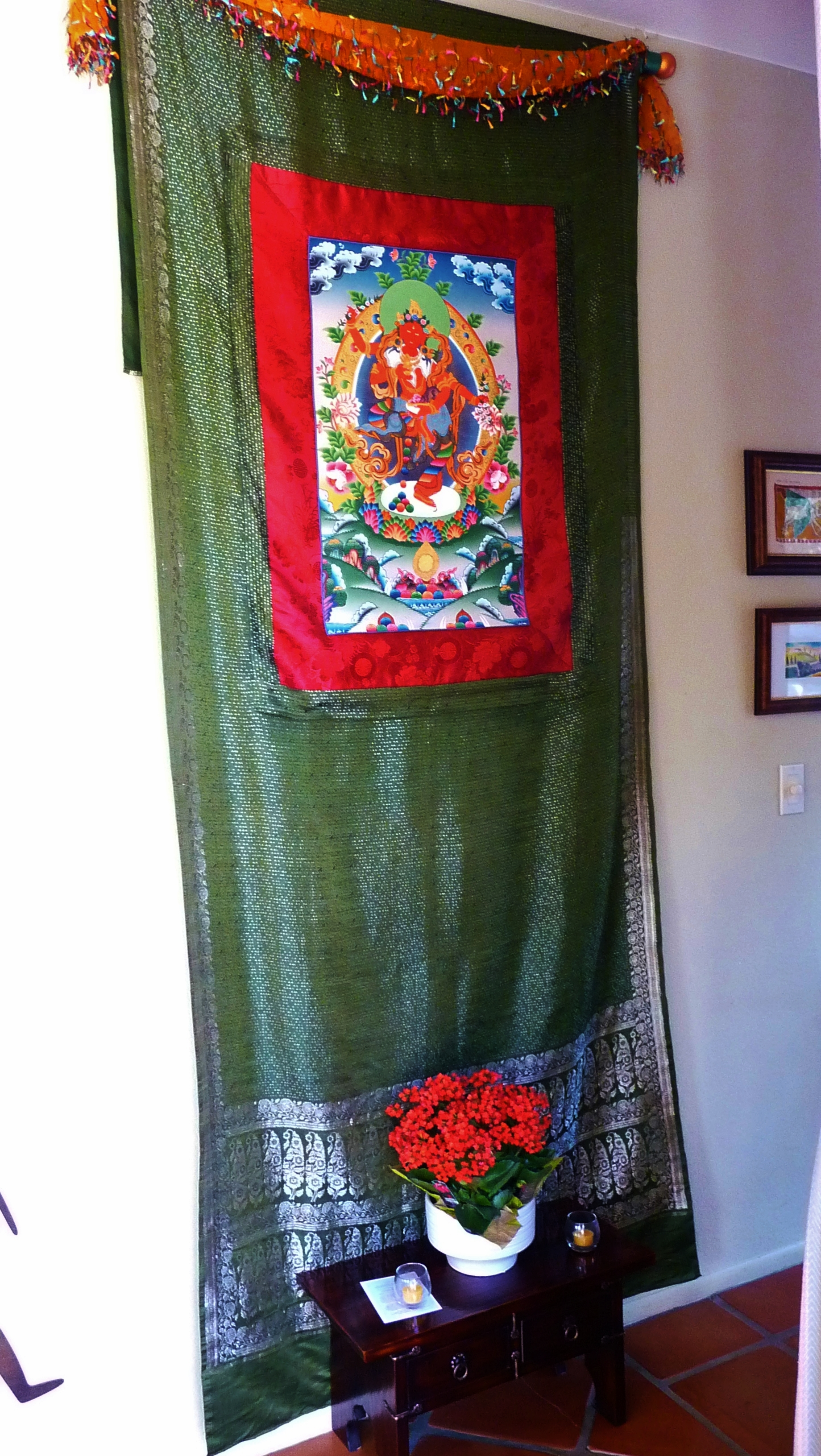 Standing Red Tara, framed to display on an Indian Sari